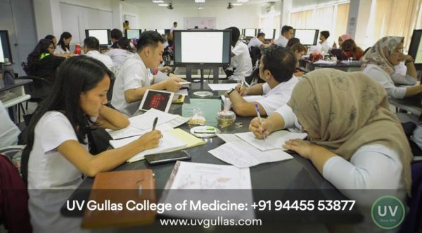 uv gullas college of medicine students in classroom and writing notes